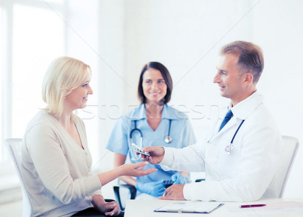 doctor giving tablets to patient in hospital Stock photo © dolgachov