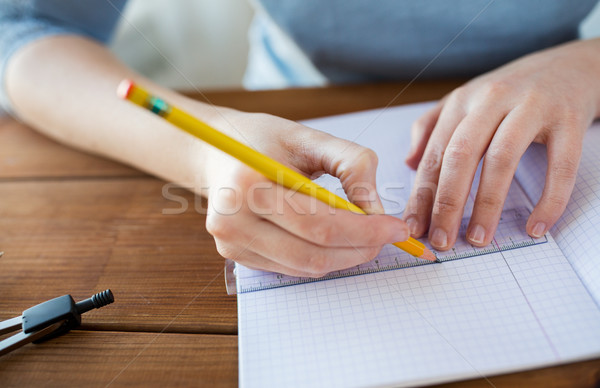 close up of hands with ruler and pencil drawing  Stock photo © dolgachov