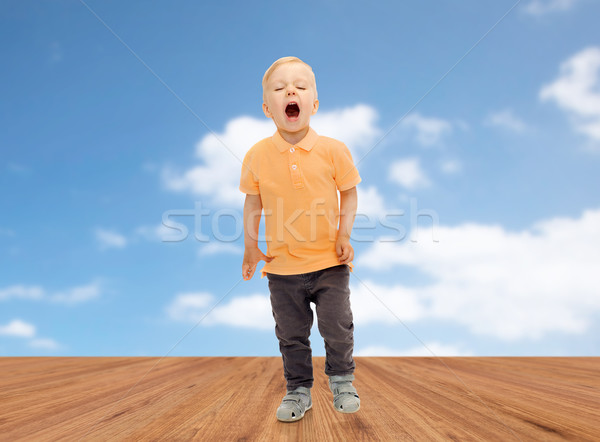 happy little boy shouting or sneezing Stock photo © dolgachov