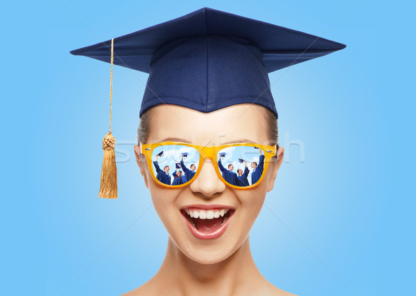 happy teenage girl in shades and mortarboard hat Stock photo © dolgachov