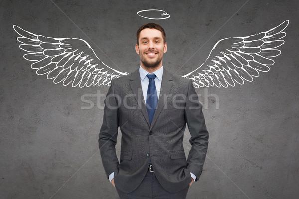 Mosolyog üzletember angyalszárnyak üzlet angyal befektető Stock fotó © dolgachov