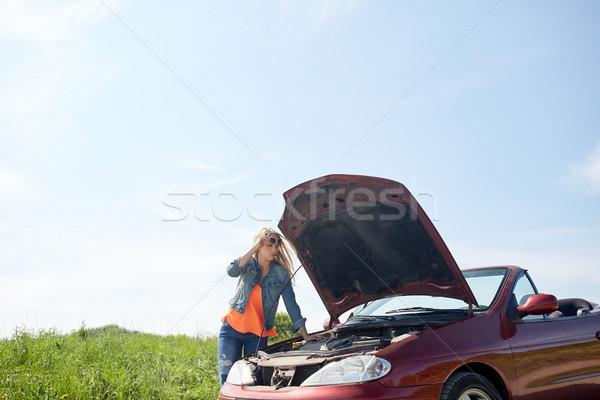 Donna open auto rotta campagna strada viaggio Foto d'archivio © dolgachov