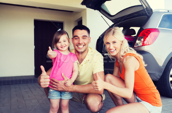 happy family with car showing thumbs up at parking Stock photo © dolgachov