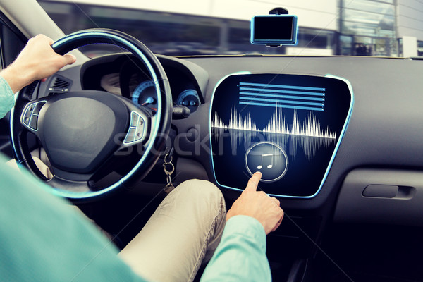 close up of man driving car with audio system Stock photo © dolgachov