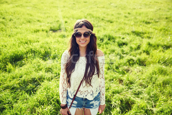 smiling young hippie woman on green field Stock photo © dolgachov