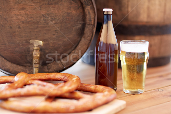 close up of beer barrel, glass, pretzel and bottle Stock photo © dolgachov