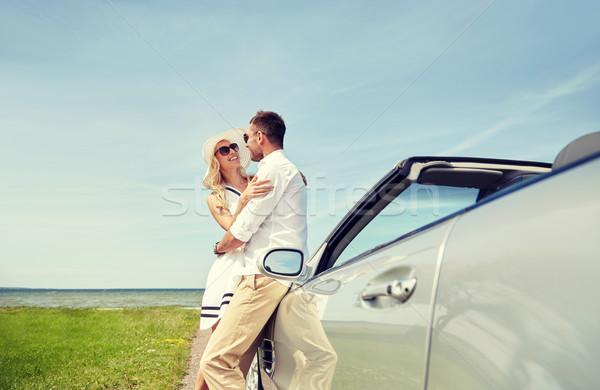 happy couple hugging near cabriolet car at sea Stock photo © dolgachov