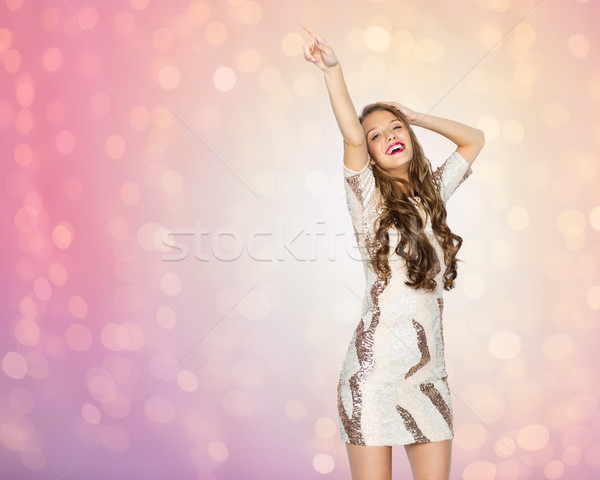 happy young woman or teen girl dancing at party Stock photo © dolgachov