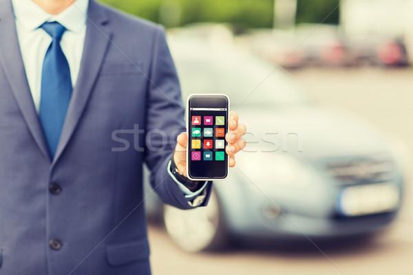 close up of business man with smartphone menu Stock photo © dolgachov