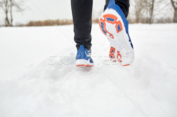 close up of feet running along snowy winter road Stock photo © dolgachov
