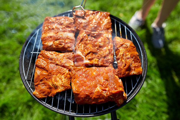 meat cooking on barbecue grill at summer party Stock photo © dolgachov