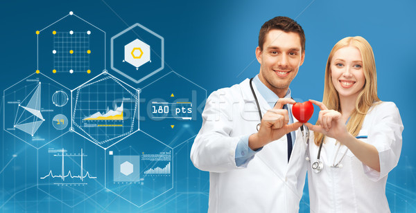 Doktorlar kırmızı kalp mavi sağlık Stok fotoğraf © dolgachov