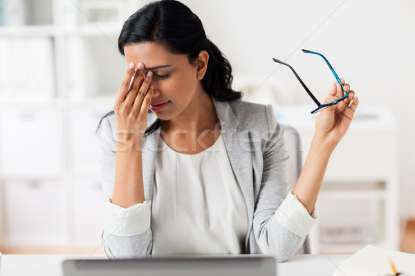 Stock photo: businesswoman rubbing tired eyes at office