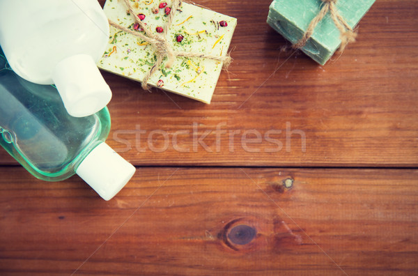 close up of handmade soap bars and lotions on wood Stock photo © dolgachov