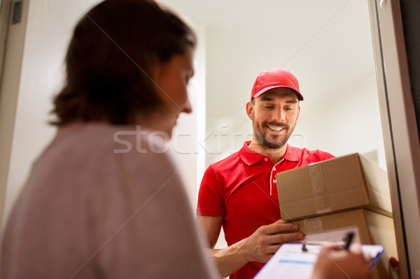 deliveryman and customer with parcel boxes at home Stock photo © dolgachov