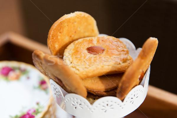 Közelkép mandula sütik váza étel gasztronómiai Stock fotó © dolgachov
