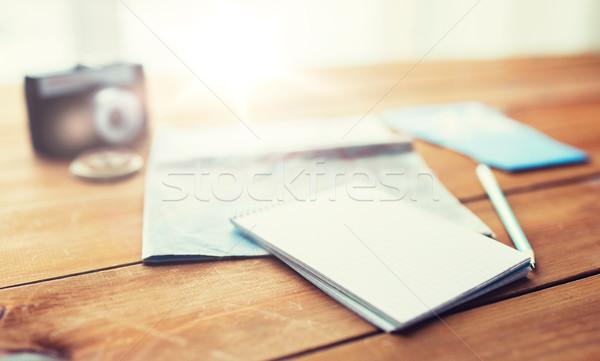 Bloco de notas mapa viajar bilhetes férias Foto stock © dolgachov
