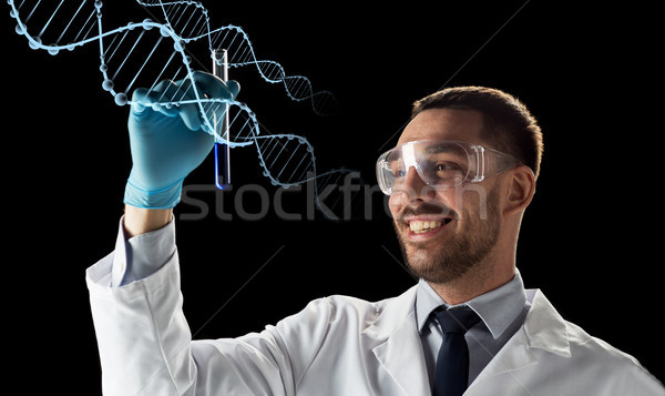 smiling scientist in safety glasses with test tube Stock photo © dolgachov