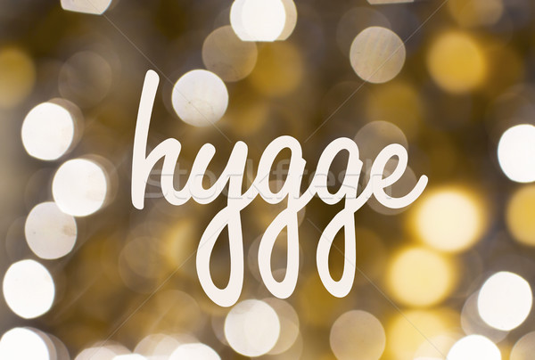 word hygge over blurred golden lights background Stock photo © dolgachov