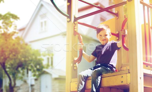 happy boy on children playground climbing frame Stock photo © dolgachov