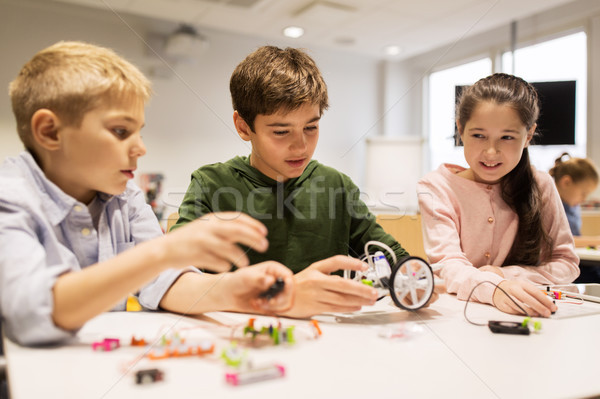 Stock photo: happy children building robots at robotics school
