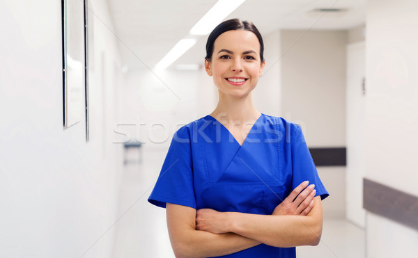 happy doctor or nurse at hospital corridor Stock photo © dolgachov