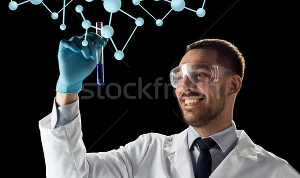 smiling scientist with test tube and molecules Stock photo © dolgachov