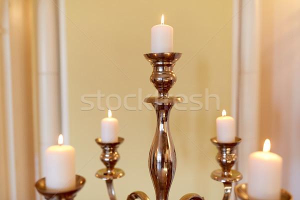 candles burning in church or palace Stock photo © dolgachov
