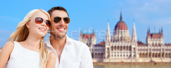 happy couple over house of parliament in budapest Stock photo © dolgachov