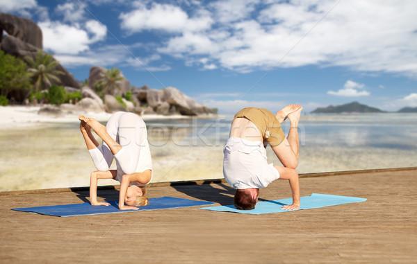çift yoga tropikal plaj uygunluk spor Stok fotoğraf © dolgachov