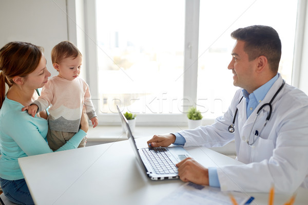 woman with baby and doctor with laptop at clinic Stock photo © dolgachov
