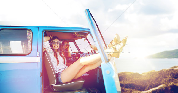happy hippie women in minivan car on summer beach Stock photo © dolgachov