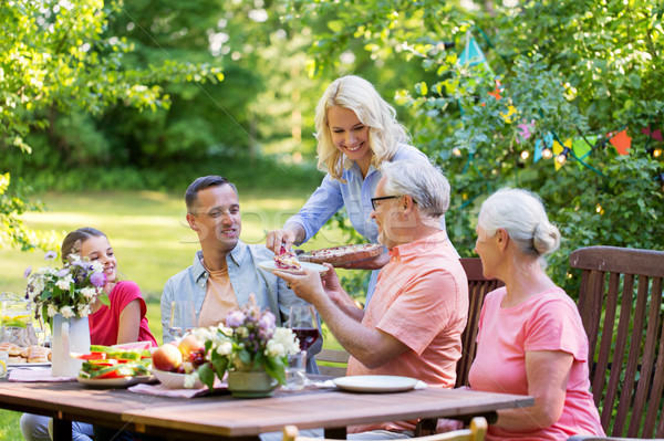 Stock photo: happy family having dinner or summer garden party