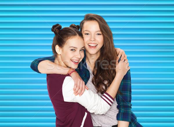 happy smiling pretty teenage girls hugging Stock photo © dolgachov