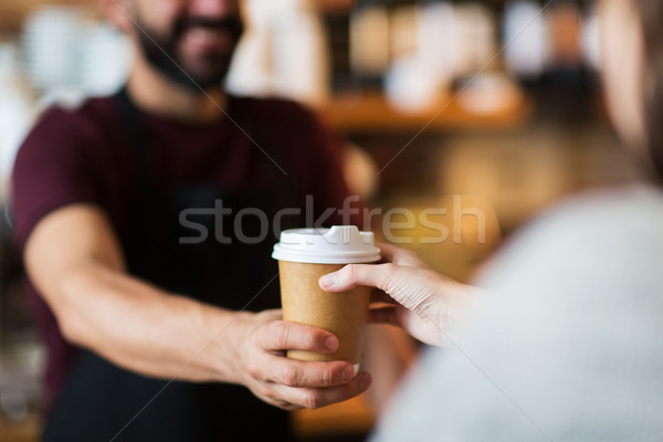 man or bartender serving customer at coffee shop Stock photo © dolgachov