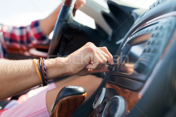 man driving car and turning switch on dashboard Stock photo © dolgachov