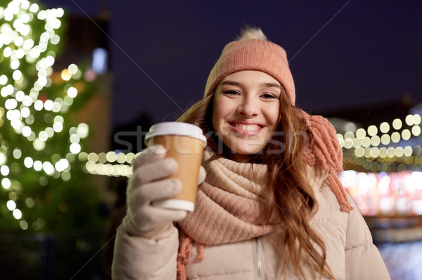 happy young woman with coffee at christmas market Stock photo © dolgachov