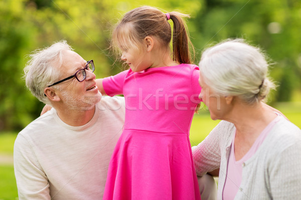 senior grandparents and granddaughter at park Stock photo © dolgachov