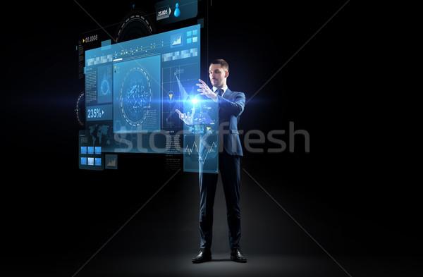 бизнесмен костюм виртуальный проекция бизнеса реальность Сток-фото © dolgachov