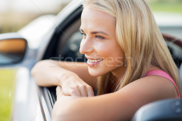 close up of happy young woman in convertible car Stock photo © dolgachov