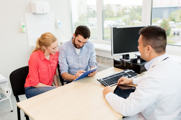 Stock photo: couple visiting doctor at family planning clinic