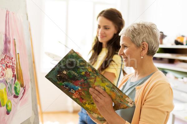 happy women painting at art school studio Stock photo © dolgachov