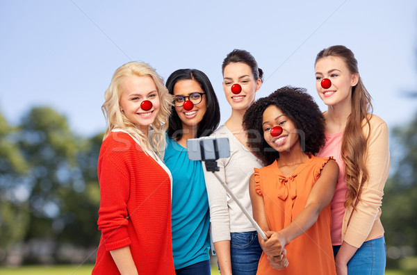 group of women taking selfie at red nose day Stock photo © dolgachov