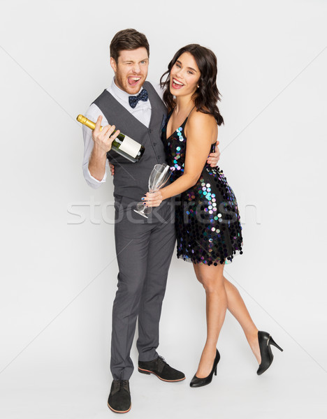 happy couple with champagne and glasses at party Stock photo © dolgachov