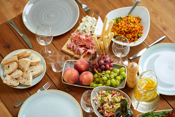 various food on served wooden table Stock photo © dolgachov