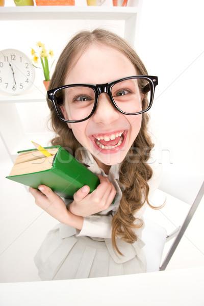 Funny dziewczyna zielone książki zniekształcony zdjęcie Zdjęcia stock © dolgachov