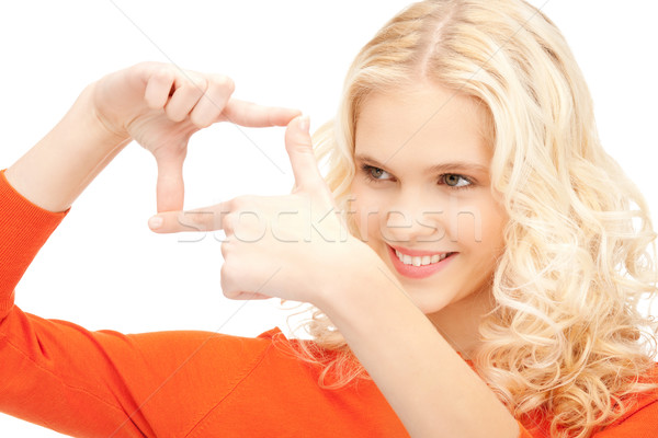 Stock photo: lovely woman creating a frame with fingers