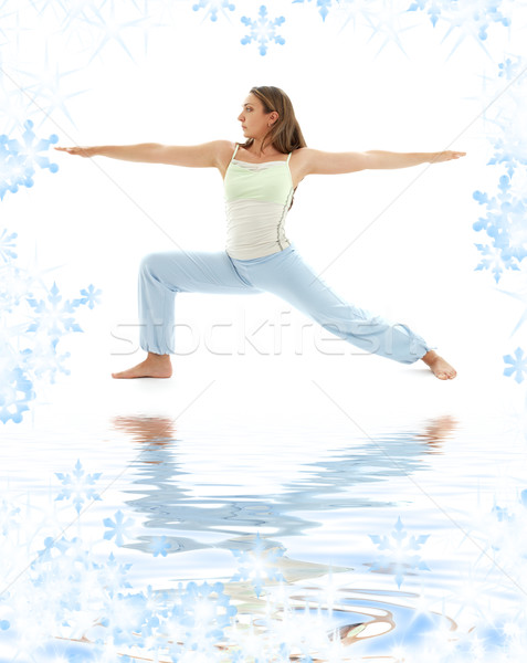 virabhadrasana warrior pose on white sand Stock photo © dolgachov