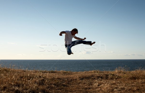 jump-kick Stock photo © dolgachov