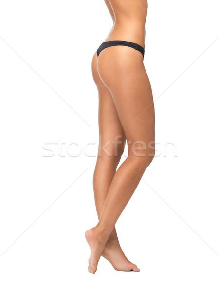 Vrouwelijke benen zwarte bikini slipje foto Stockfoto © dolgachov